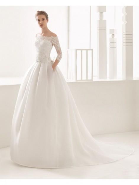 DONNA FABRIZIA - abito da sposa Le Spose di Milano Shop Online  - Abito haute couture con corpetto di pizzo e gonna di organza.